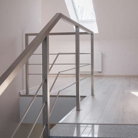 handrail: Steel handrail and marble stairs in luxurious modern house