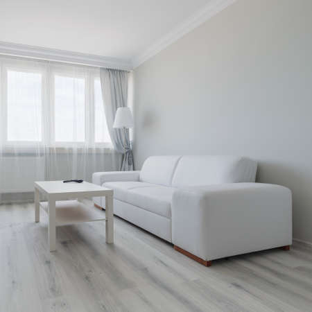 living room minimalist: Horizontal view of white living room design Stock Photo