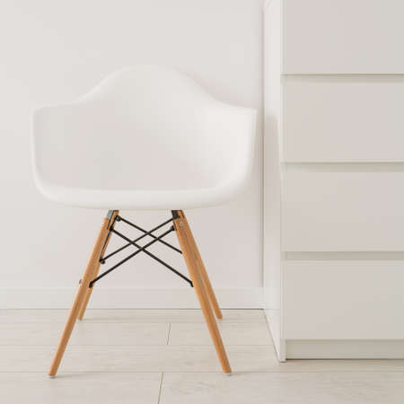 wooden furniture: Close-up of white chair in modern design