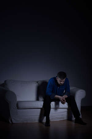 man sad: Vertical image of a lonely mature man in empty apartment Stock Photo