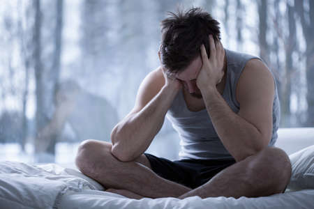 rest: Photo of depressed and tired man after sleepless night