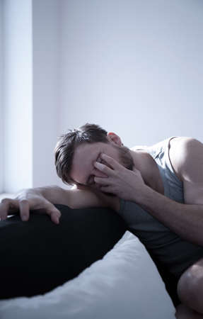 sleeplessness: Image of young male with hangover after party