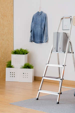Picture of silver ladder standing in artist atelier