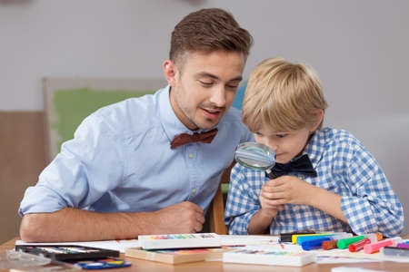 drawing boy: Picture of smart boy learning through play with private teacher