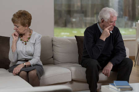 insulted: Silent sad elderly couple after another arguing