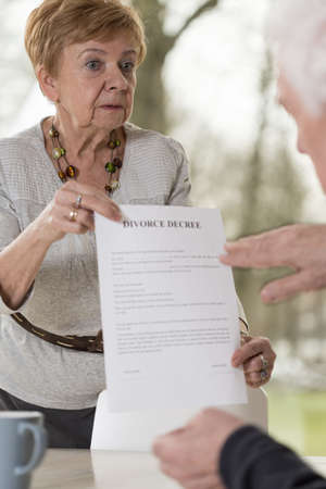 dissolution: Aged lady is holding a divorce decree