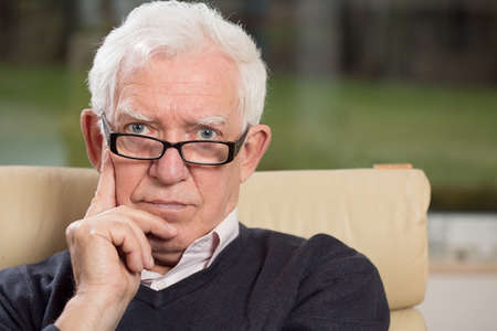 man with glasses: Portrait of intelligent senior man wearing glasses Stock Photo