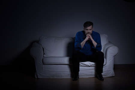 distraught: Picture of a man mentally distraught after loss of relative Stock Photo