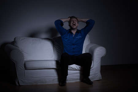 woman alone: Horizontal picture of man mourning after loss of loved one