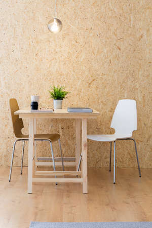 Photo of simple design studio with eco wooden furniture Stock Photo