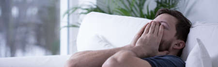 and anxiety: Panoramic view of exhausted young man after sleepless night Stock Photo