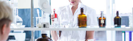 pharmacy equipment: Close-up of woman working in chemistry lab
