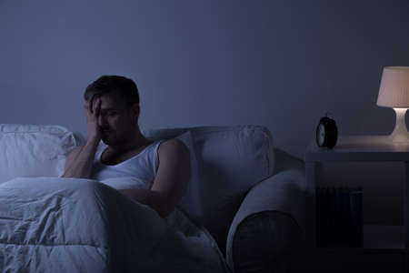 mood: View of a man at night suffering from deep depression Stock Photo