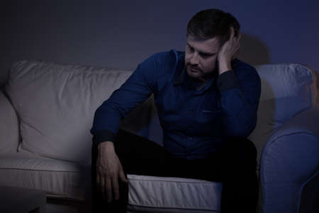 friendless: Horizontal view of a suffering lonely man secluded from society Stock Photo