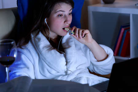 Eating late at night in front of the computer Stock Photo