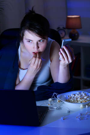 inconclusive: Modern teenager addicted to social media and technology Stock Photo