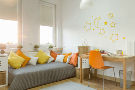 orange color: Color details in modern cozy girls room