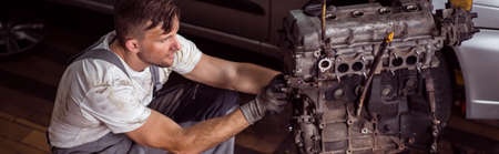 motor car: Auto mechanic changing motor in the car Stock Photo