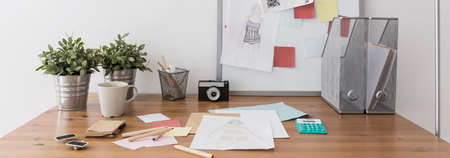 decoration messy: Panorama of workspace for young fashion designer Stock Photo