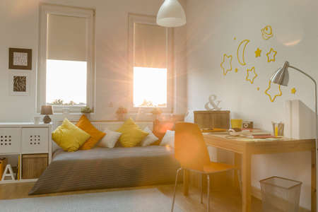 interior decoration accessories: Yellow and orange decorations in modern teen room
