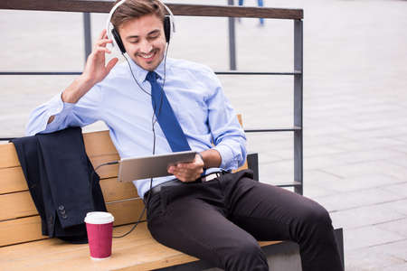 voyager: Image of business voyager with tablet and headphones on station Stock Photo