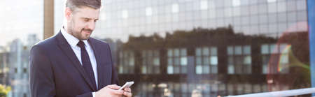 sending: Businessman sending text message to employee - panorama