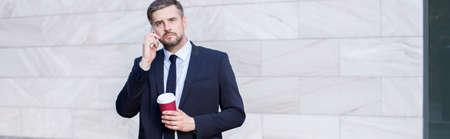 panoramic business: Panorama of busy businessman taking away coffee Stock Photo