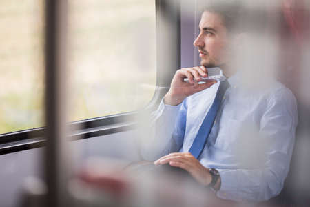 man in suit: Picture of handsome businessman using commuter rail