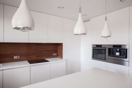 interior lighting: Photo of decorative lighting in contemporary style kitchen interior Stock Photo