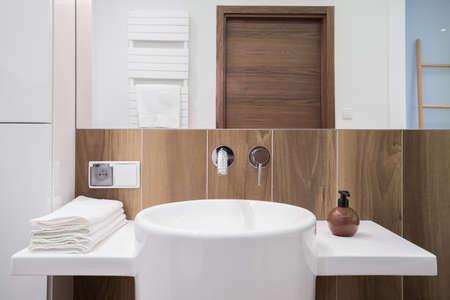 wainscot: Image of elegant white bathroom with decorative wooden backsplash Stock Photo
