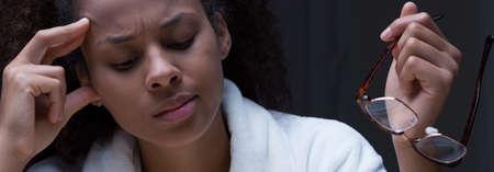 weary: Panorama of weary afroamerican girl in white robe Stock Photo