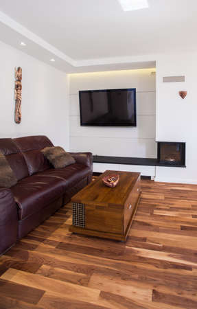 living room design: Photo of elegant living room with leather sofa