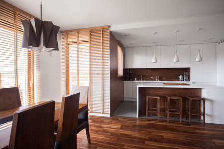 wood blinds: Image of functional open kitchen in contemporary design house