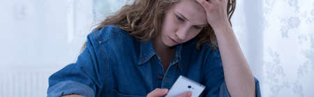 bullied: Teen girl being bullied by text message