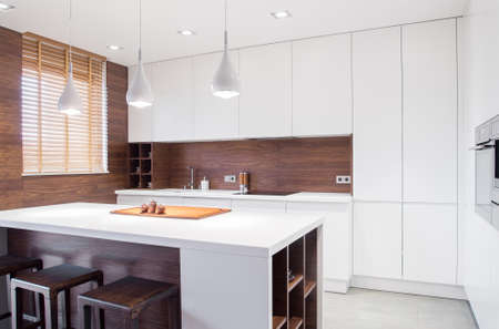 interior lighting: Image of modern design spacious light kitchen interior Stock Photo