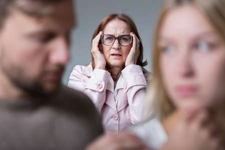 intrusive: Woman concerned about negative tensions in family Stock Photo