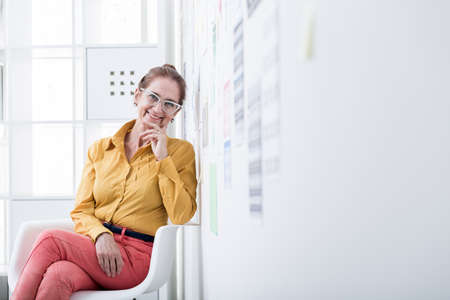 executive chair: Picture of female executive director sitting in office chair