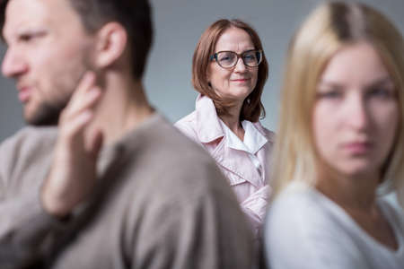 intrusive: Mother-in-law satisfied with her sons relationship problems Stock Photo