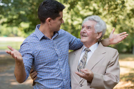 father and son: Photo of father and son relaxing together in park Stock Photo