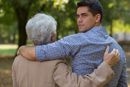 intergenerational: Image of intergenerational friendship between senior man and his grandson
