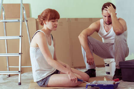 renovating: Image of despair young couple renovating house Stock Photo