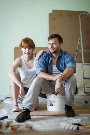 redecoration: Young happy couple during renovation of house