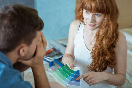 decorating: Young marriage redecorating apartment and painting walls Stock Photo