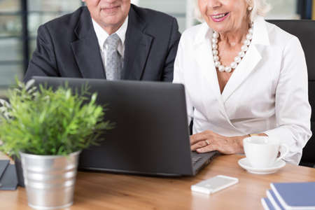 use computer: Elder smart business people know how to use computer