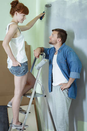 redecoration: Marriage doing renovation and painting walls in new apartment Stock Photo