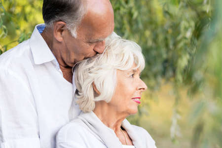 embracing couple: Senior couple love spending time close to nature Stock Photo