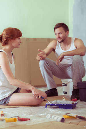 redecorating: Young happy married couple redecorating their apartment