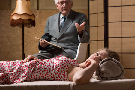 despair: Elder male psychoanalyst talking with despair woman
