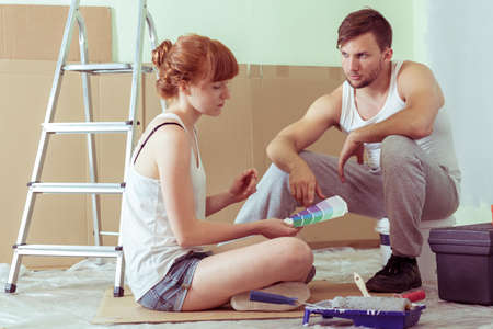 redecoration: Young undecided couple choosing color for walls