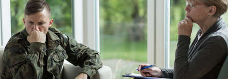 traumatic: Soldier with war trauma visiting a professional therapist